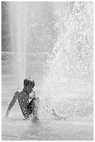 Boy playing in water,  Cesar de Chavez Park. San Jose, California, USA (black and white)
