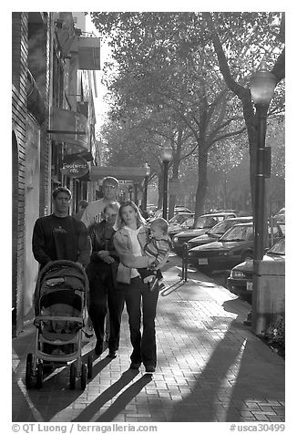 Family strolls on the sidewalk of University Avenue. Palo Alto,  California, USA (black and white)