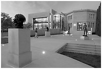 Rodin sculpture garden and Cantor Center for Visual Arts with one visitor. Stanford University, California, USA ( black and white)