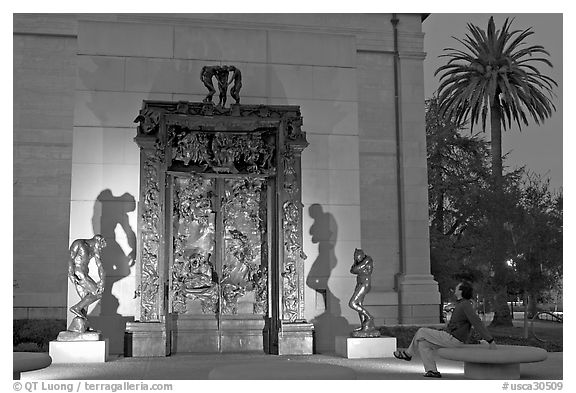 Visitor contemplating Rodin's Gates of Hell in the Rodin sculpture garden. Stanford University, California, USA (black and white)