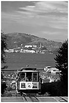 Cable car and Alcatraz Island, late afternoon. San Francisco, California, USA (black and white)