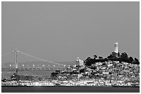 Telegraph Hill and Bay Bridge at dusk. San Francisco, California, USA (black and white)