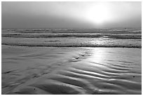 Foggy sunset over the ocean. Morro Bay, USA (black and white)