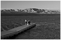 Fishing on San Luis Reservoir at sunset. California, USA ( black and white)