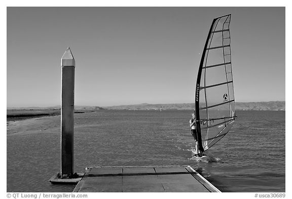 Windsurfer near deck, Palo Alto Baylands. Palo Alto,  California, USA (black and white)
