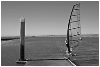 Windsurfer near deck, Palo Alto Baylands. Palo Alto,  California, USA ( black and white)