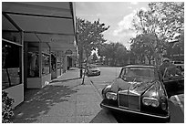 Goodwill store and Rolls-Royce on  Santa Cruz avenue. Menlo Park,  California, USA ( black and white)