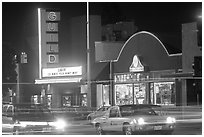 El Camino Real at night, with movie theater and Menlo Clock Works. Menlo Park,  California, USA ( black and white)