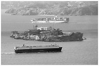 Cargo ships and Alcatraz Island in the San Francisco Bay. San Francisco, California, USA (black and white)