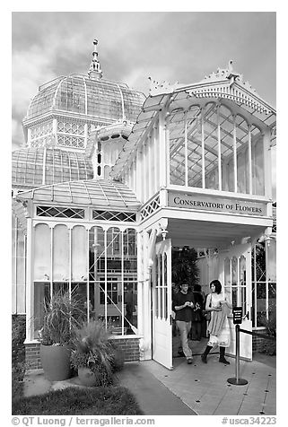 Couple exiting the Conservatory of Flowers. San Francisco, California, USA (black and white)