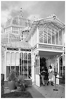 Couple exiting the Conservatory of Flowers. San Francisco, California, USA ( black and white)