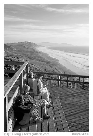 Enjoying sunset from the observation platform at Fort Funston. San Francisco, California, USA (black and white)