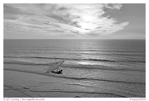 Hang glider flying  above ocean, Fort Funston, sunset. San Francisco, California, USA (black and white)