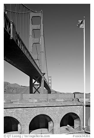 Fort Point courtyard, flag pole, and Golden Gate Bridge. San Francisco, California, USA (black and white)