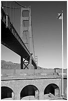 Fort Point courtyard, flag pole, and Golden Gate Bridge. San Francisco, California, USA ( black and white)
