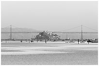 Alcatraz Island and Bay Bridge, sunset. San Francisco, California, USA (black and white)