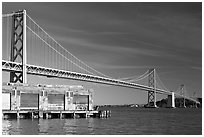 Old pier and Bay Bridge, early morning. San Francisco, California, USA ( black and white)