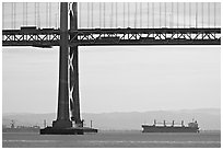 Tanker ship and Bay Bridge,  morning. San Francisco, California, USA (black and white)