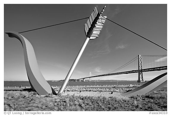 Modern sculputure called Cupid's arrow, framing the Bay Bridge. San Francisco, California, USA (black and white)