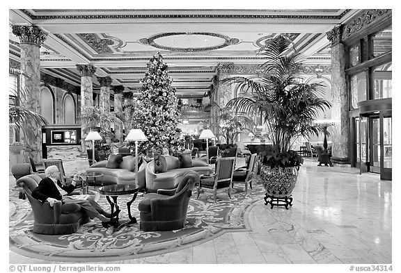 Man sitting in the lobby of the Fairmont Hotel. San Francisco, California, USA (black and white)