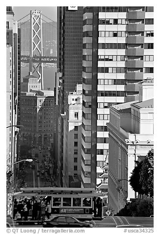 Cable-car, Chinatown, Financial District and Bay Bridge. San Francisco, California, USA (black and white)