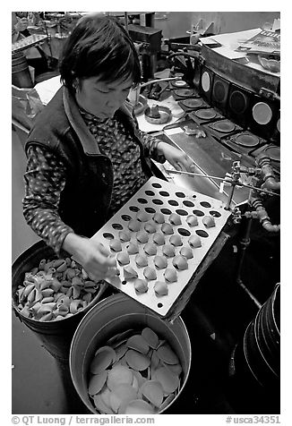Fortune cookies being folded with great dexterity, Chinatown. San Francisco, California, USA (black and white)