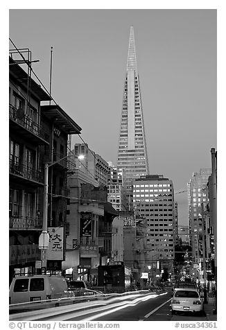 Chinatown street and Transamerica Pyramid, dusk. San Francisco, California, USA (black and white)