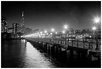 Skyline, Pier 7 lights and reflections at night. San Francisco, California, USA (black and white)
