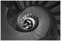 Children standing at the bottom of stairwell, Point Loma Lighthous. San Diego, California, USA ( black and white)