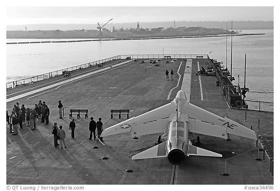 Plane in position at catapult, USS Midway aircraft carrier. San Diego, California, USA (black and white)