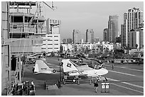 Flight control tower, aircraft, San Diego skyline, USS Midway aircraft carrier. San Diego, California, USA ( black and white)