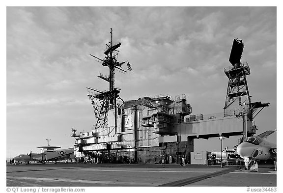 Flight deck and island, USS Midway aircraft carrier, late afternoon. San Diego, California, USA (black and white)