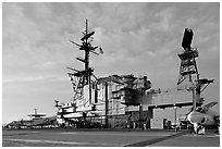 Flight deck and island, USS Midway aircraft carrier, late afternoon. San Diego, California, USA ( black and white)