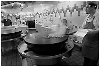 Cook preparing Mongolian BBQ, Horton Plaza. San Diego, California, USA ( black and white)