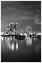 Yachts and skyline from Harbor Drive, at night. San Diego, California, USA ( black and white)