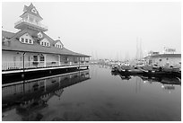 Period and modern boathouses in fog, Coronado. San Diego, California, USA (black and white)