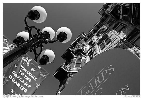 Gaslamp, welcome to Gaslamp quarter signs, and historical building facade. San Diego, California, USA (black and white)