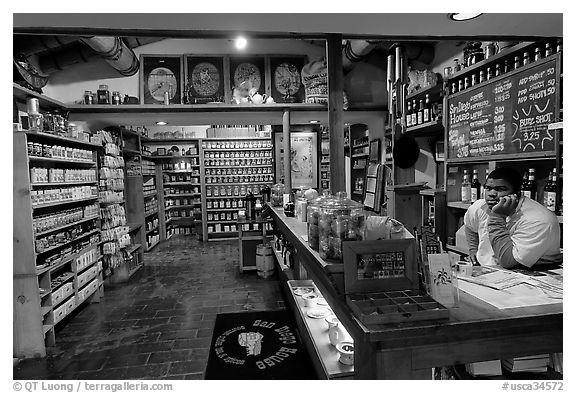 Man at the counter of Tea store,  Old Town. San Diego, California, USA (black and white)