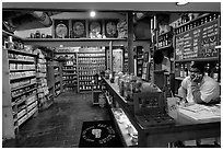 Man at the counter of Tea store,  Old Town. San Diego, California, USA ( black and white)