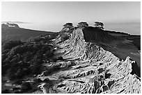 Eroded sandstone cliffs of Broken Hill,  Torrey Pines State Preserve. La Jolla, San Diego, California, USA ( black and white)