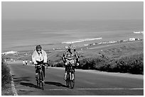 Bicyclists and ocean, Torrey Pines State Preserve. La Jolla, San Diego, California, USA ( black and white)