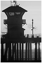 Lifeguard tower on Huntington Pier at sunset. Huntington Beach, Orange County, California, USA ( black and white)