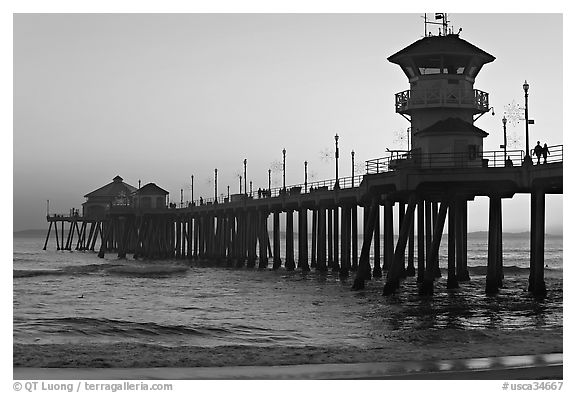 The 1853 ft Huntington Pier at sunset. Huntington Beach, Orange County, California, USA (black and white)