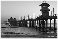 The 1853 ft Huntington Pier at sunset. Huntington Beach, Orange County, California, USA ( black and white)
