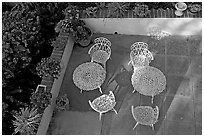 Courtyard with garden chairs and tables. Laguna Beach, Orange County, California, USA ( black and white)