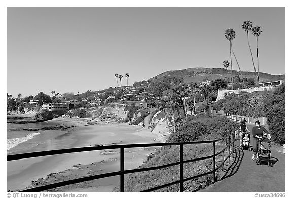 Black and white picture photo women pushing babies in strollers in heisler park above picnic beach laguna beach orange county california usa