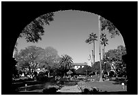 Central courtyard framed by an archway. San Juan Capistrano, Orange County, California, USA ( black and white)