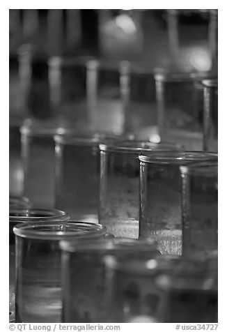 Candles in red glass, background blurred. San Juan Capistrano, Orange County, California, USA (black and white)
