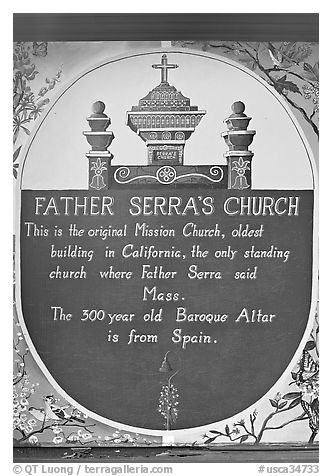 Sign explaining historical significance of Serra Chapel. San Juan Capistrano, Orange County, California, USA (black and white)