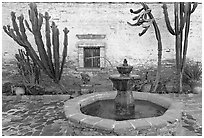 Sacred Garden, with fountain and cacti. San Juan Capistrano, Orange County, California, USA ( black and white)